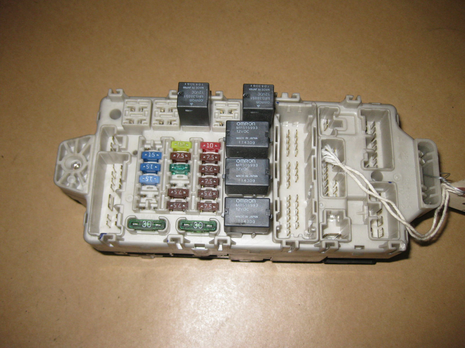This is a indash fuse box with fuses and theft locking module removed from  a 2003 Mitsubishi Eclipse. Part # Is MR587195. SHOULD fit 00-05 Mitsubishi  ...