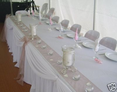 SKIRTING AND DECORATIONS NOT INCLUDED for a bridal table