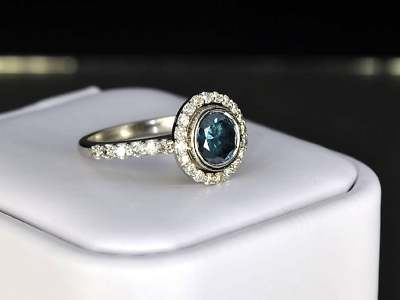 Blue Diamond Bezel Engagement Ring
