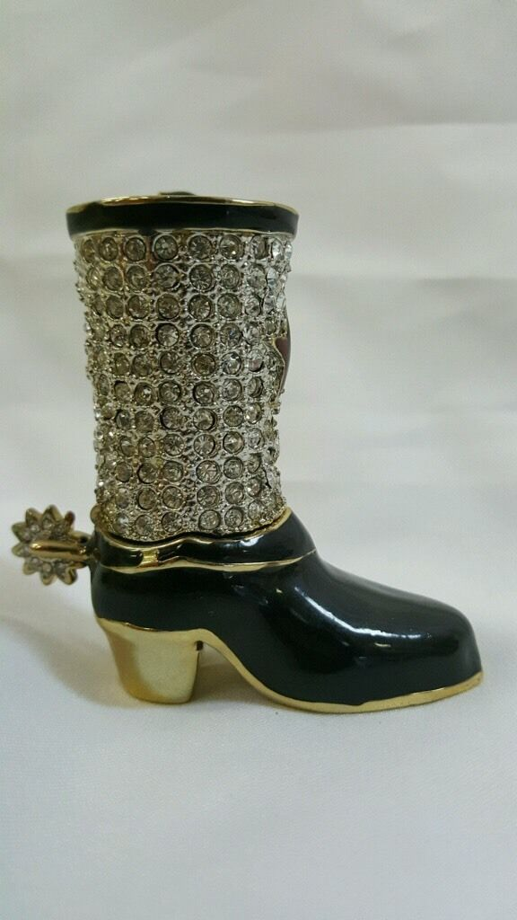 black and gold cowboy boot with spur and rhinestone decor