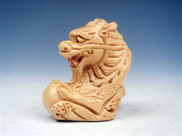 Boxwood hand carved netsuke sculpture miniature dragon